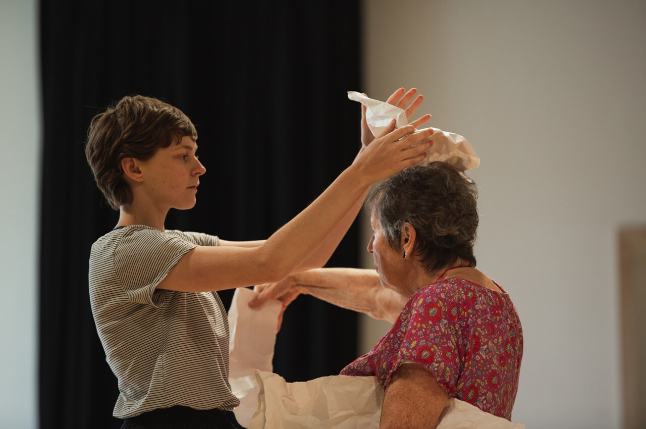 Woman placing paper on head   Collective Identity